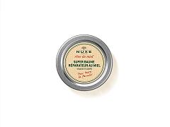 Възстановяващият супер балсам с мед на NUXE е специално създаден за сухите и чувствителни зони на тялото (брадичка, нос, лакти и т.н.), които се нуждаят от продукт с възстановяващи и подхранващи съставки.