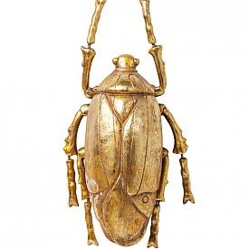 Тези златни бръмбари могат да се поставят на стената или на масата в хола за щипка екстравагантност в интериора