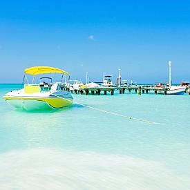 АРУБА, ЗАДМОРСКО ВЛАДЕНИЕ НА КРАЛСТВО НИДЕРЛАНДИЯ, Всъщност, това е остров в Карибско море, но пък е отлично място за райска почивка: бели пясъци, чисто море, изгоден шопинг, барове и интересни пътешествия на острова.