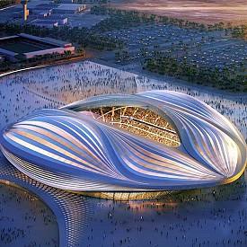 Това е един от последните проекти на Заха Хадид, която почина през май 2016 г. Строежът му е съпроводен със скандали, свързани с непосилните условия на труд на работниците. През май 2015 г правозащитната организация Amnesty International съобщава, че строежът на съоражението за Световната купа през 2022 г в Катар е отнел живота на 441 работника. Но това не единственият проблем на стадиона – външният вид на конструкцията напомня на женски гениталии според местните жители.