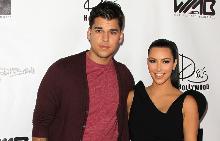 Робърт със сестра си Ким на една от последните си публични изяви през 2011 г.