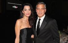 Джордж и Амал Клуни приютиха иракски бежанец