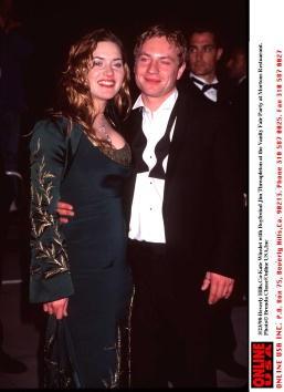 През 1998 г. Кейт Уинслет  е с червената коса на Роуз,...