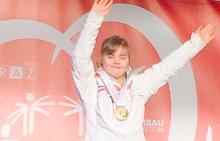 Радена с олимпийския медал