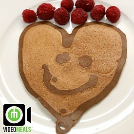 Raspberry pancakes  1- In a bowl mix 2 eggs, 80ml (1/3 cup) low fat Greek yogurt, 80ml (1/3 cup) whole wheat flour, about a teaspoon of baking powder, and 80ml (1/3 cup) raspberries.  2- Draw shape on pan with pancake mix and leave it for about 30 seconds.  3- Fill in the rest of the shape and wait till its ready to flip (about another 30 seconds  4- Flip and cook for a little longer.  NOTES: Feel free to make any shape and tag me! have fun with this!! Happy Valentines Day!! You could make this easy by using the pancake printer!!! Approx. Macros: Kcal:390 Carbs:38g Fat:16g Protein:25g
